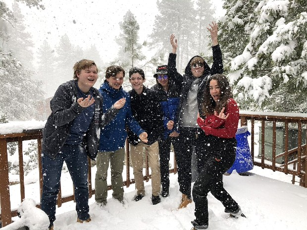 teenagers having fun in the snow